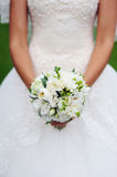 Bride hands holding bouquet Stock Image