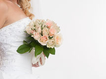 Bride hands holding wedding bouquet Stock Photo