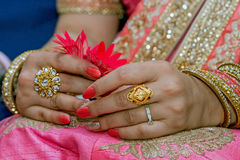 Bride. Hands of an Indian bride adorned with jewellery and bangles Royalty Free Stock Images