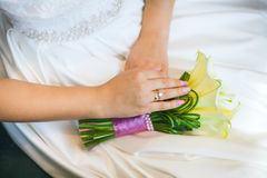 Bride hands with ring over the wedding dress Stock Image