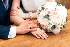 Bride hands with ring and wedding bouquet of flowers. Bride hands with ring and wedding bouquet Stock Photos