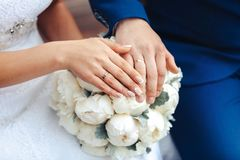 Bride hands with ring and wedding bouquet of flowers. Bride hands with ring and wedding bouquet Stock Image