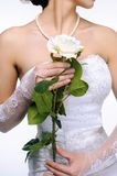 Bride hands with rose Royalty Free Stock Images
