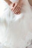 Bride hands on wedding dress Stock Image