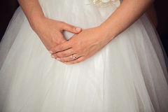 Bride hands on wedding dress Royalty Free Stock Photography