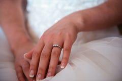 Bride hands on wedding dress Stock Photo