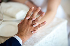 Bride hands with wedding rings, close-up Stock Photo