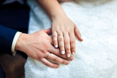 Bride hands with wedding rings, close-up Stock Image