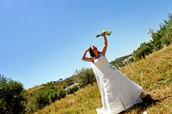 Bride happiness. Bride in the middle nature with church as background Stock Images