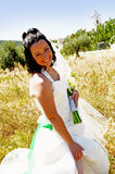 Bride happiness. Bride in the middle nature with church as background Royalty Free Stock Photography
