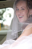 Bride Happy. A bride with a veil on her head before wedding ceremony Royalty Free Stock Photography