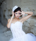 Bride in hat near stone wall Stock Photos