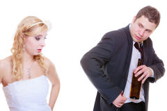 Bride having argument with drunk alcoholic groom Stock Photography