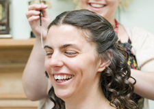 Bride having hair styled Royalty Free Stock Photo
