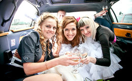 Bride having hen-party in limousine Royalty Free Stock Image