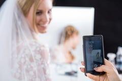 Bride having taken photo Royalty Free Stock Image