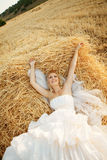 Bride in hay stack Royalty Free Stock Image