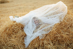 Bride in hay stack royalty free stock photography