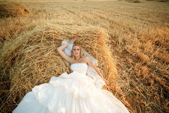 Bride in hay stack royalty free stock photos