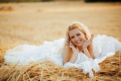 Bride in hay stack Royalty Free Stock Images