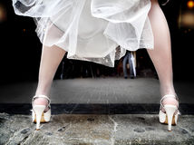 Bride with heels legs outdoor background with boyfriend Royalty Free Stock Photography