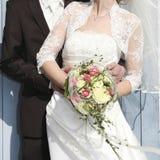 Bride is held by groom Royalty Free Stock Photo