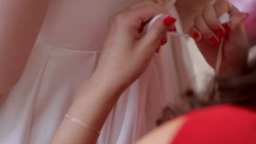 The bride help to put wedding dress stock video