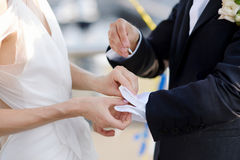 Bride helping her groom with his cufflinks Stock Photography