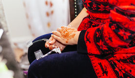 Bride henna carved beautiful bride's hand Royalty Free Stock Image