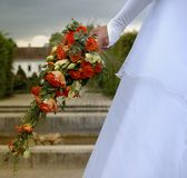 Bride with her boquet. Shot from behind Royalty Free Stock Photo