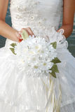 Bride with her bouquet. Woman in a wedding dress with her bouquet Stock Images