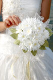 Bride with her bouquet. Woman in a wedding dress with her bouquet Royalty Free Stock Photo