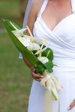Bride and her bouquet. A vertical photograph of a caucasion bride holding her bouquet Stock Photography