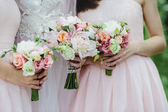 The bride and her bridesmaid with flowers Stock Photography