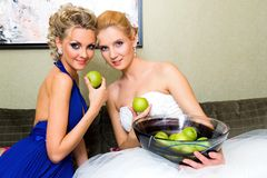 The bride and her bridesmaid with a glass of wine stock images