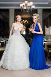 Bride and her Bridesmaid in a restaurant Stock Photos