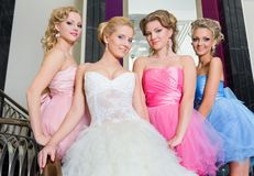 The bride with her bridesmaids on the stairs Royalty Free Stock Photos
