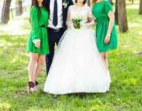 Bride and her bridesmaids wearing light green bridesmaid dresses Stock Images