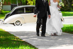 Bride and her Father Entering inside the Church. During a Beautiful Summer Day Royalty Free Stock Photos