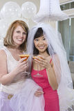 Bride And Her Friend Holding Juice Glasses Royalty Free Stock Images