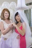 Bride With Her Friend Looking At Engagement Ring Royalty Free Stock Photography
