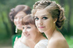 Bride with her friends. Beautiful bride with her friends Stock Photography