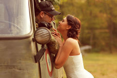 Bride with her groom wearing army suit Stock Photo