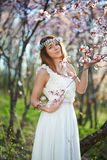 Bride with her hair in a spring garden royalty free stock photos