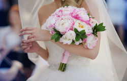 Bride with her peonies bouquet Royalty Free Stock Photography