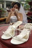 Bride with her shoes stock photos