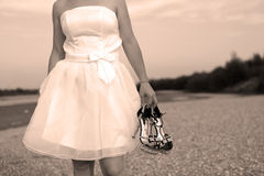 Bride with her shoes Stock Photo