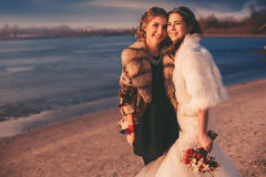 Bride and her sister on the beach Royalty Free Stock Photography