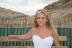 A bride with her wedding dress at the beach Royalty Free Stock Photo