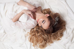 The bride in her wedding dress lay. Alone Stock Images
